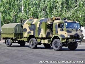 Многоцелевой кузов-фургон К4350-11К на шасси КамАЗ-43501 с прицепом 7158 КАФ Шумерля на салоне Комплексная Безопасность 2014 - 1