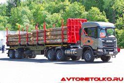 Седельный тягач Scania Scania G500 A6x6HZ с полуприцепом c кониками «Новосиб АРЗ» на презентации в Дмитрове
